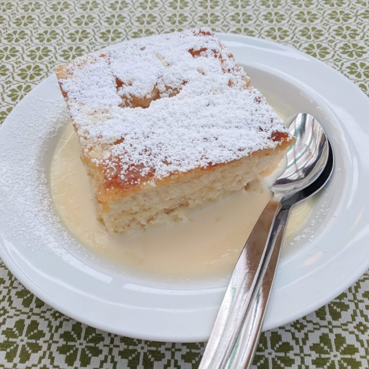 dampfnudel on a plate on a green and white table cloth