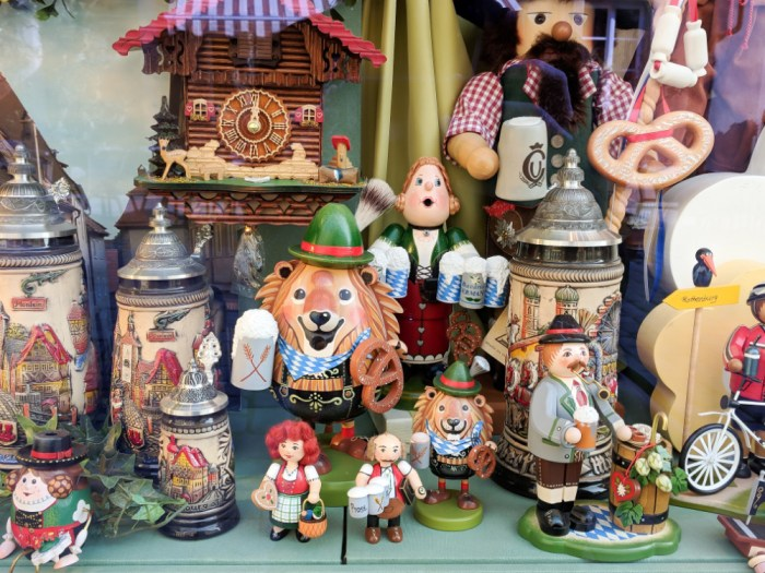 Collection of German trinkets and incense smokers in a shop window in Rothenburg