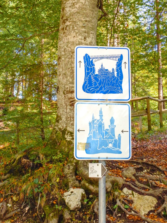 Signs to the castle and the Marienbrucke bridge   10 Crucial Tips to Visit Neuschwanstein Castle Skillfully and Worry-Free   Tips for visiting Neuschwanstein Castle in Bavaria, Germany   Neuschwanstein Castle tour tickets