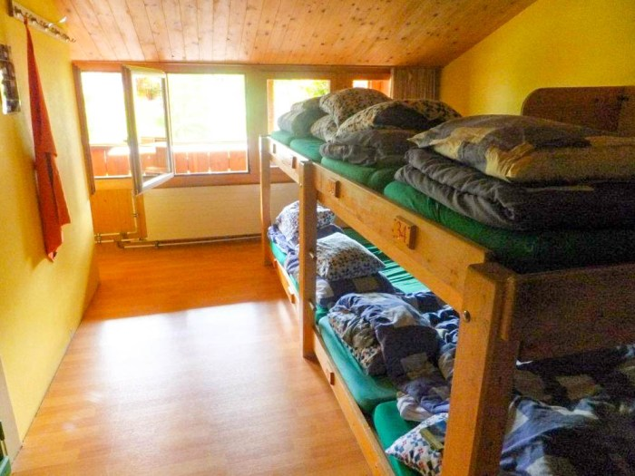 Mountain Hostel bunk bed rooms | Where to stay in Gimmelwald, Switzerland: Mountain Hostels and B&Bs | Best places to stay in Gimmelwald