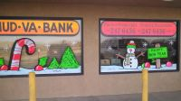 Custom holiday window painting for your drive by customers.