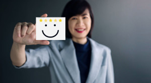 Customer Experience Concept, Happy Business Woman holding Card w