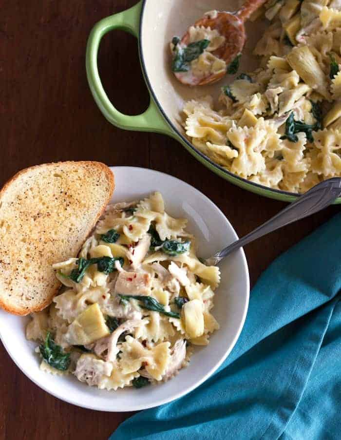 Busy weeknights call for easy and delicious pasta! This creamy Spinach Artichoke Chicken Pasta checks all the right boxes!