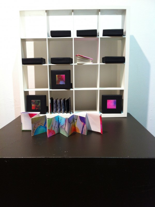 Mini books in boxes by Joei Lau