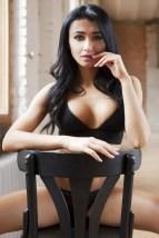 Sexy Girl auf dem Stuhl