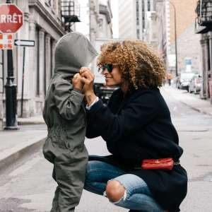 Mom and her child on a street of Montreal