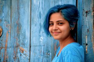 blue-haired-girl-smiles
