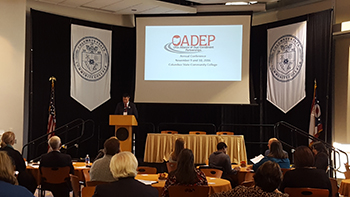 person speaking at the OADEP conference