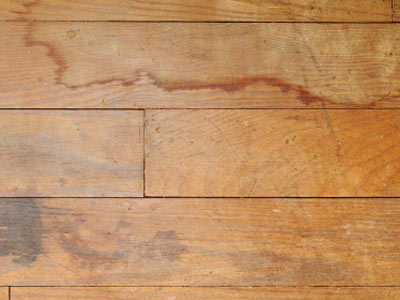 This laminate flooring shows signs of water staining.
