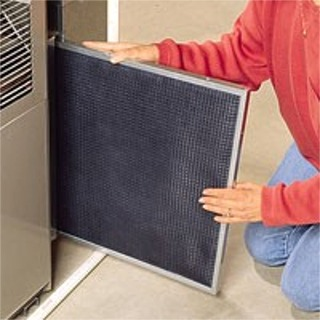 The air filter slides out for easy replacement