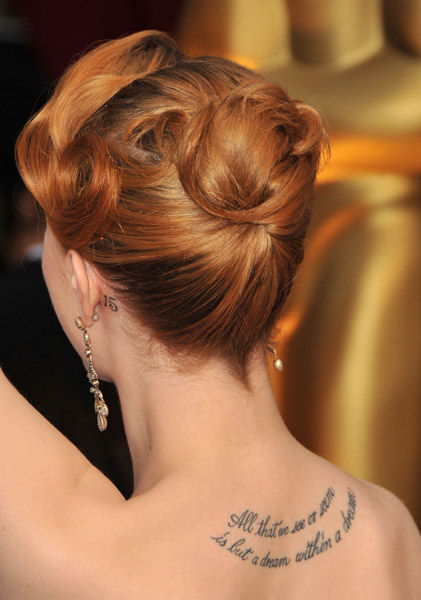 Evan Rachel Wood, sporting a 15 tattoo behind her left ear, not quoted as