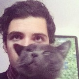 Ever Laffer of Dub Thompson with a cat