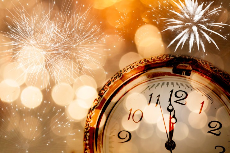 New Year greeting card with vintage clock and holiday lights