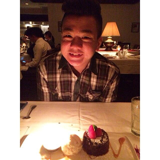 The birthday boy with his chocolate lava cake.
