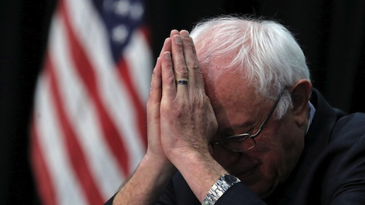 Bernie Sanders praying