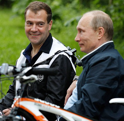 A bloated Putin and his lap dog Medvedev
