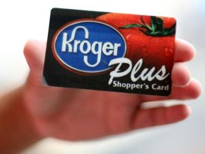 Hand holding up Kroger Plus shopping card