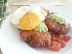 Wilder - Prawn and Corn Fritter, avocado, homemade tomato salsa topped with egg