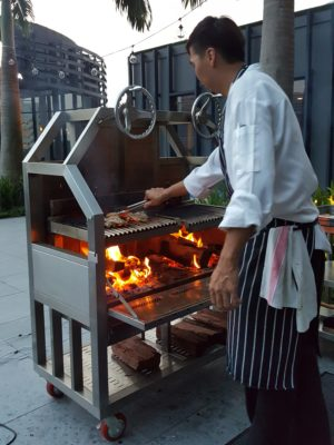 The Carvery's Hearth & Heat BBQ At Park Hotel Alexandra - Grilling in progress by Chef