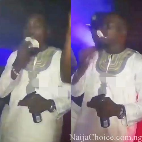 Hillarious Young Man Seen Eating Naira Notes In A Nightclub (Photos+Video) , Demonic or Lifestyle?