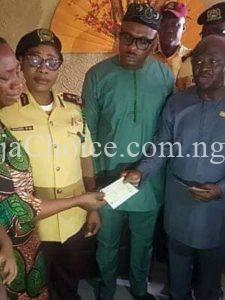 Tears Of Joy As Wife Of Slain LASTMA Officer Receives N10Million From Lagos Government (Photos)