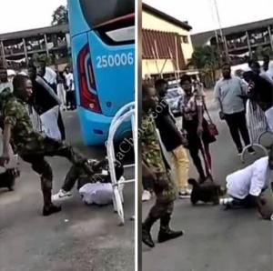 Nigerian Soldier Caught On Camera Brutalizing Boy For Wearing Camouflage Trouser To An Event (Video)