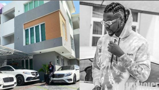 Celebrities react as Kizz Daniel flaunts his wealth with photo of his mansion and car collection
