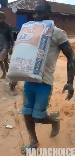 Man Carries 50kg Bag Of Cement With Teeth, Wins 100,000 Naira Bet (Video, Pix)
