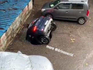 Sinkhole Swallows A Car At A Parking Lot In India (Video)