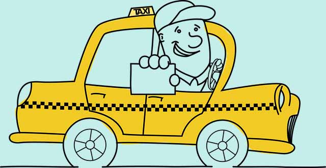 A driver in his yellow taxi cab