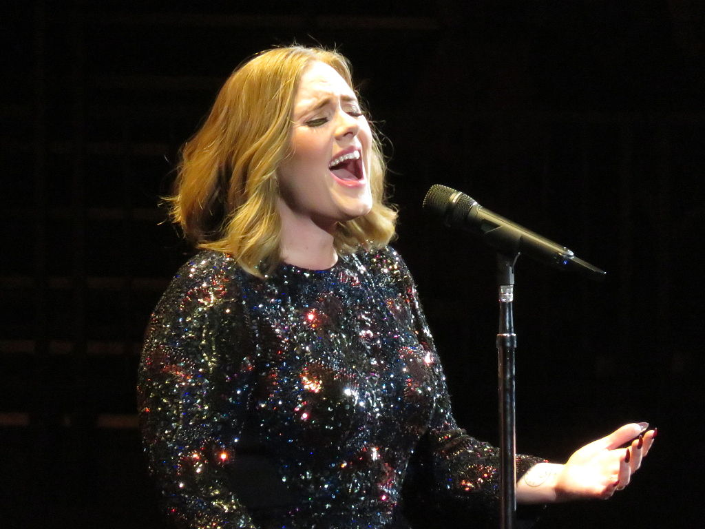 Adele performing in a live concert in 2016