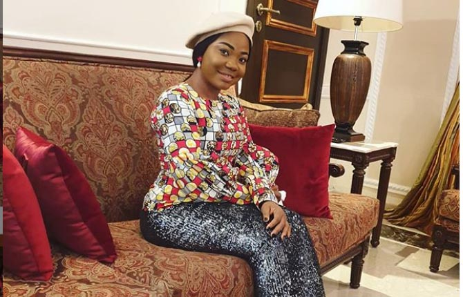 Mercy Chinwo sitting on a couch