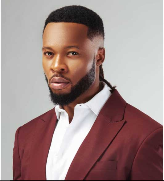 Flavour Nabania in brown suit