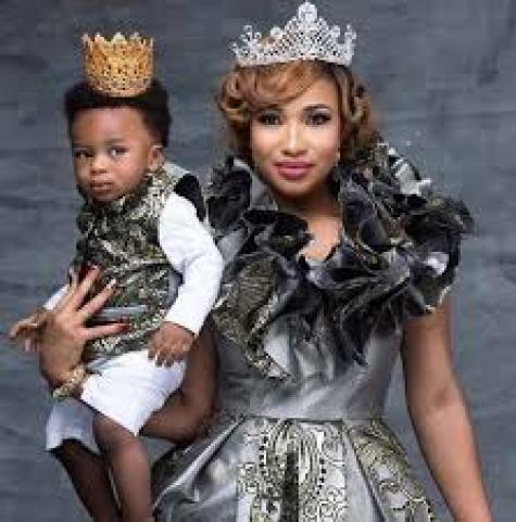 Tonto Dikeh and her son wearing a crown