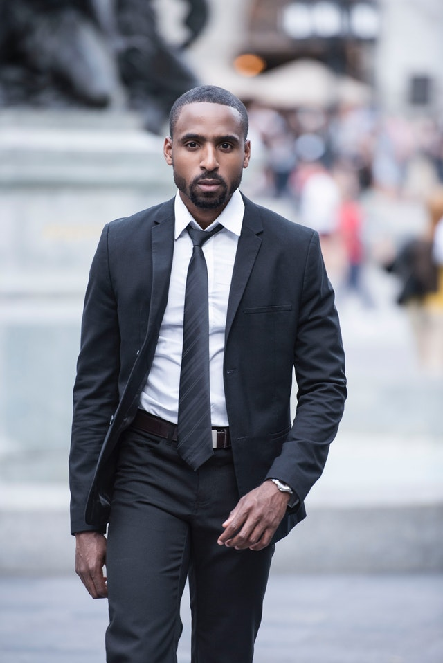 An accountant in a black suit