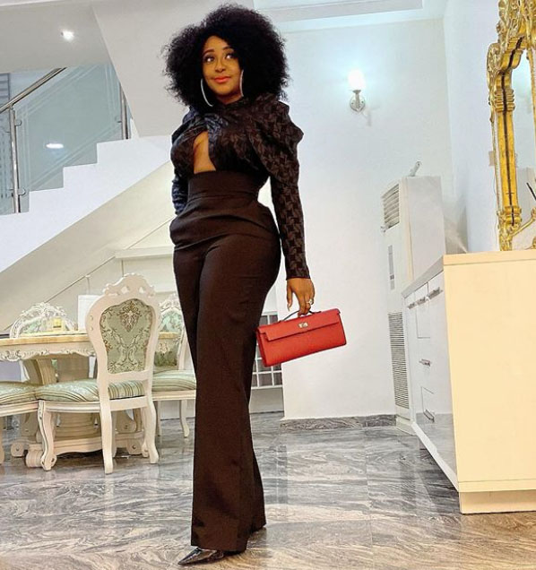 Ini Edo looking beautiful in a brown baggy trouser