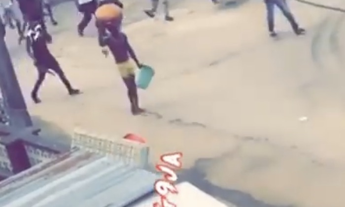 A Suspected Yahoo Boy Caught Carrying A Big Sacrifice This Morning In Agege, Lagos State (Watch Video)