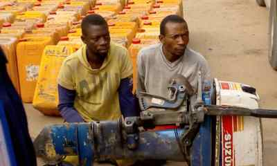 Photo Of Two Nigerian Fishermen Caught Trying To Smuggle Petrol To Benin Republic