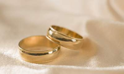 Bride in trouble for kissing another man on wedding day