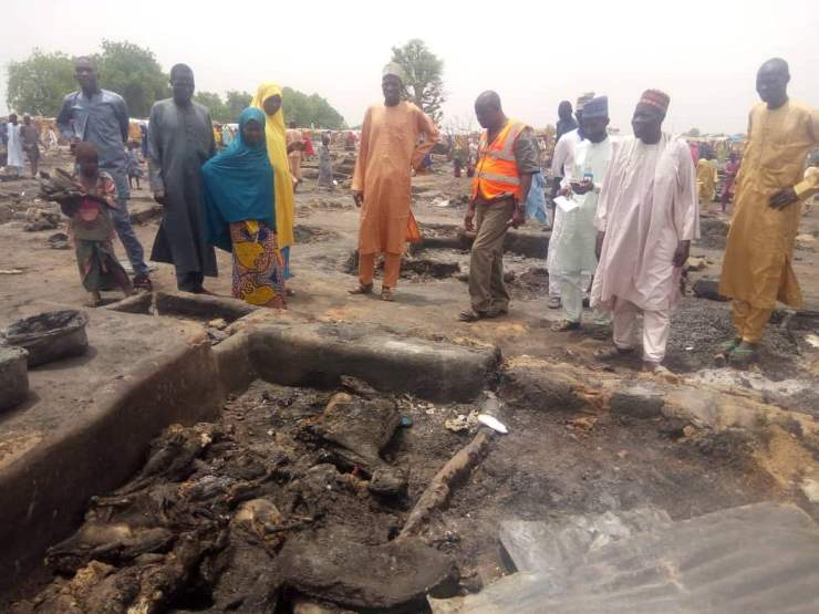 EYza3JUWoAA8NAk - One Dead, Many Injured And Property Destroyed As Fire Ravages IDP Camp In Borno (Photos)