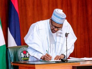 buhari signs 2020 revised budget into law