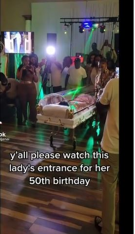 Woman Celebrates Her 50th Birthday In A Transparent Coffin, Nigerians React
