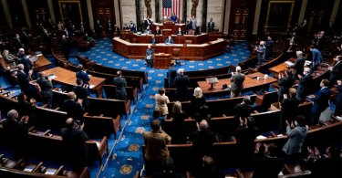 Republican and Democrats clap as House Minority Leader Kevin McCarthy (R-CA) commends Capitol Police and law enforcement for their work after Pro-Trump demonstrators stormed the Capitol in the House chamber on January 6, 2021 in Washington, D.C. Pool/Getty Images/AFP