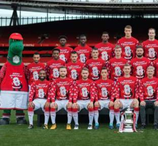 Santi Carzola missing in Arsenal annual Christmas jumper team photo
