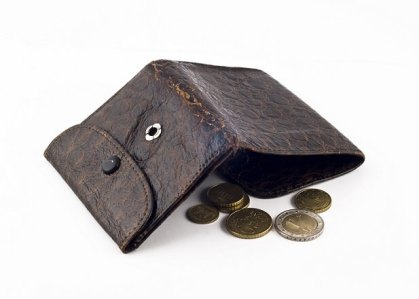 Frayed wallet with change