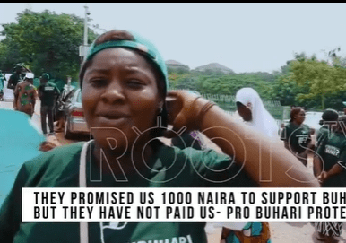60c4bec1d8387 - June12: ''They promised us N1000''- #IstandforBuhari supporter claims (video)