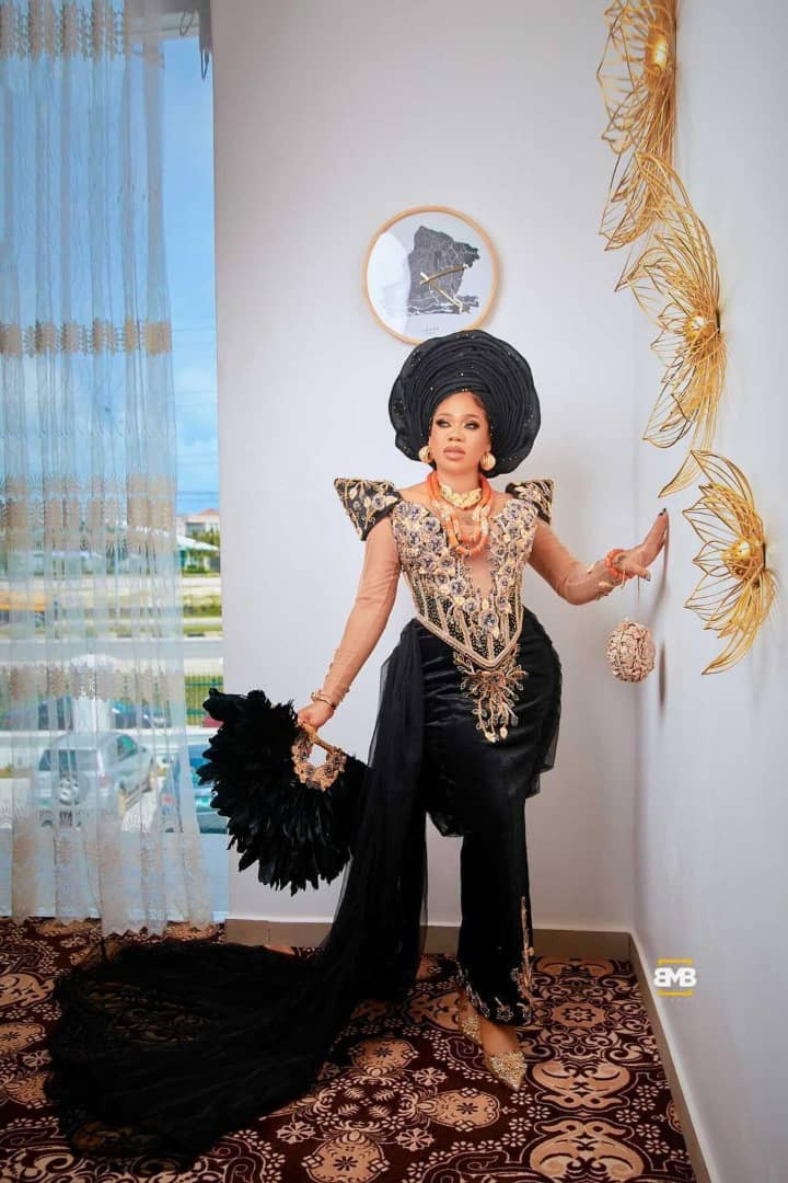60c4dc1573aaa - First photos and videos from Toyin Lawani's traditional wedding