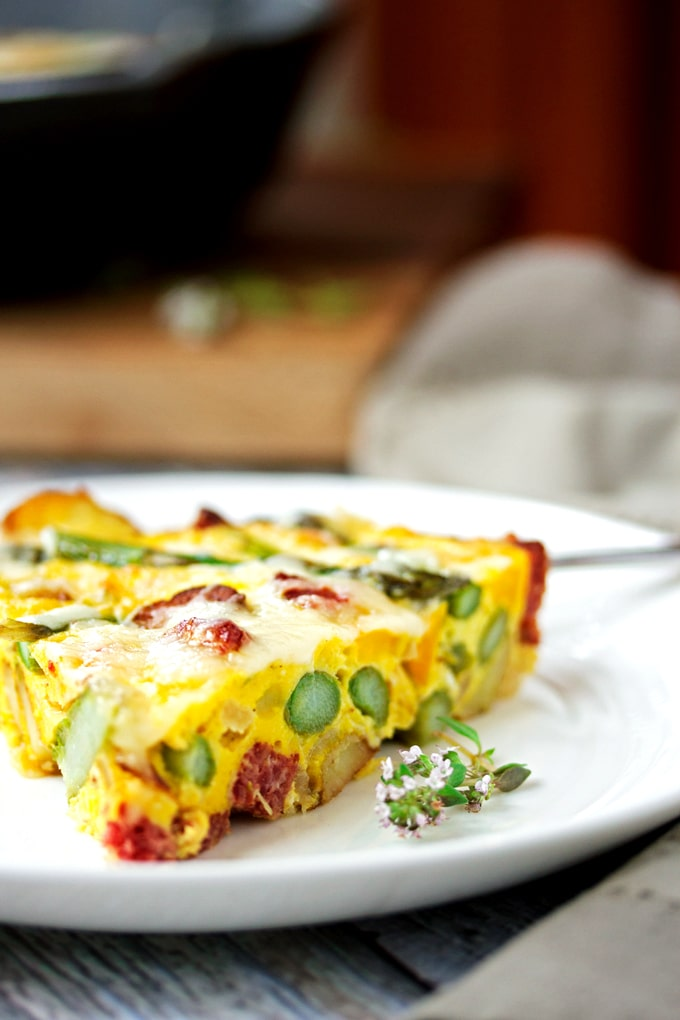 a slice of frittata on a white plate