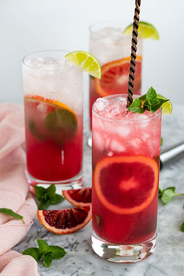 a cocktail with the blood orange juice and the club soda mixed together.