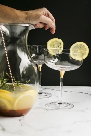 add a lemon slice to the glass